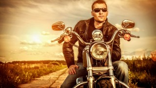 man_riding_motorcycle-wide