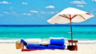 sofa_and_umbrella_on_the_beach-wide