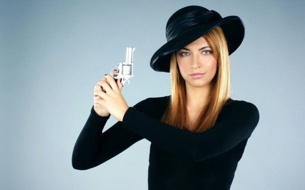 Beautiful-Woman-with-a-Gun-in-Hand