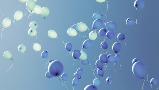 Blue-Balloons-Flying-in-the-Sky