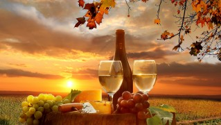Bottle-of-Wine-with-Fruits-at-Sunset