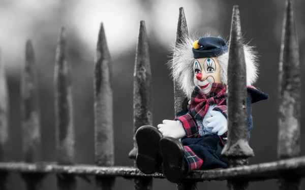 Clown-Toy-Sitting-on-Fence