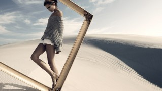 Girl-Model-Standing-with-Empty-Wooden-Frame
