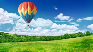 Hot-Air-Balloon-Over-Green-Landscape