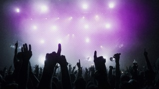 People-with-Hands-Up-in-Night-Party-and-Concert