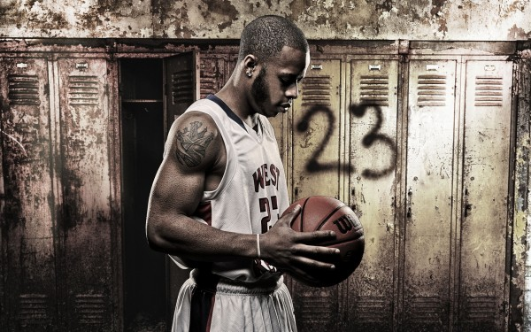 Player-Holding-Basketball-in-Change-Room