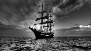Saling-Ship-in-the-Middle-of-Stormy-Ocean