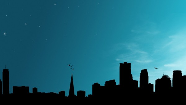 Silhouette-of-City-AGainst-Blue-Backbground