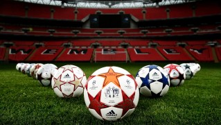 Soccer-Footballs-in-the-Stadium-Field