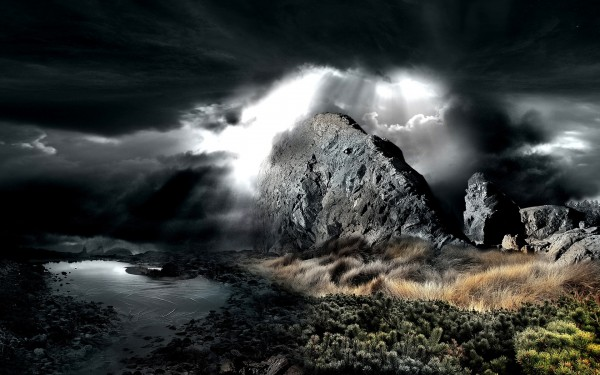Sunshine-Through-Dark-Clouds-Over-the-Mountains