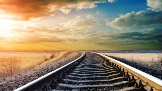Train-Track-at-Sunrise-with-Landscape