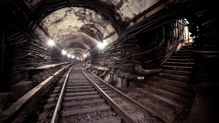 Train-Tracks-Inside-Dark-Tunnel