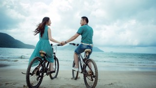 Two-Lovers-Riding-Bicycle-on-the-Beach