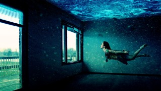Woman-Swining-In-Room-Full-of-Water