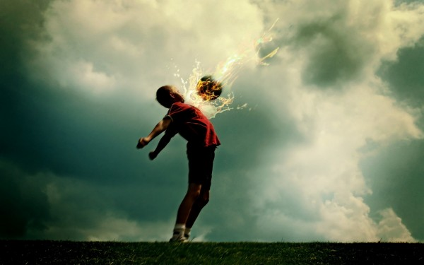 Young-Boy-Chest-Kick-of-Fire-Football