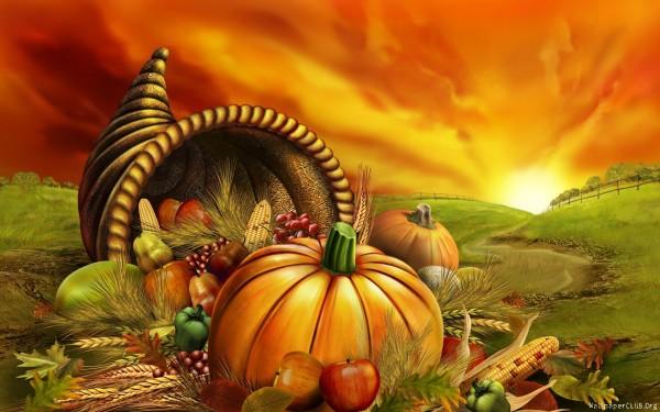 basket_with_fruits_against_sunrise_landscape-wide
