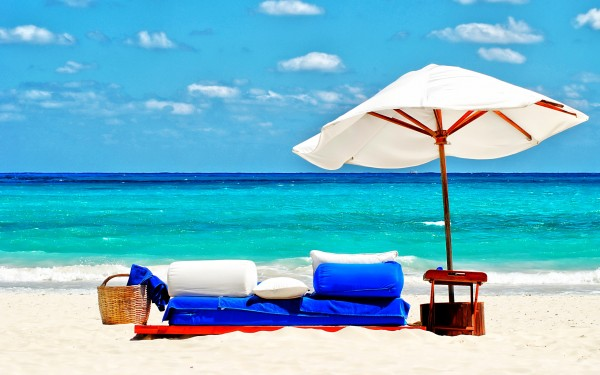 sofa_and_umbrella_on_the_beach-wide